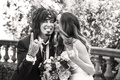 Black and white photo of Nikki Sixx and Courtney Bingham