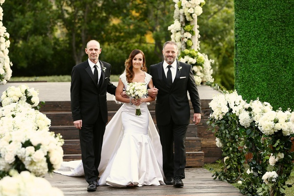 Ashley Hebert walked down aisle by father and step dad