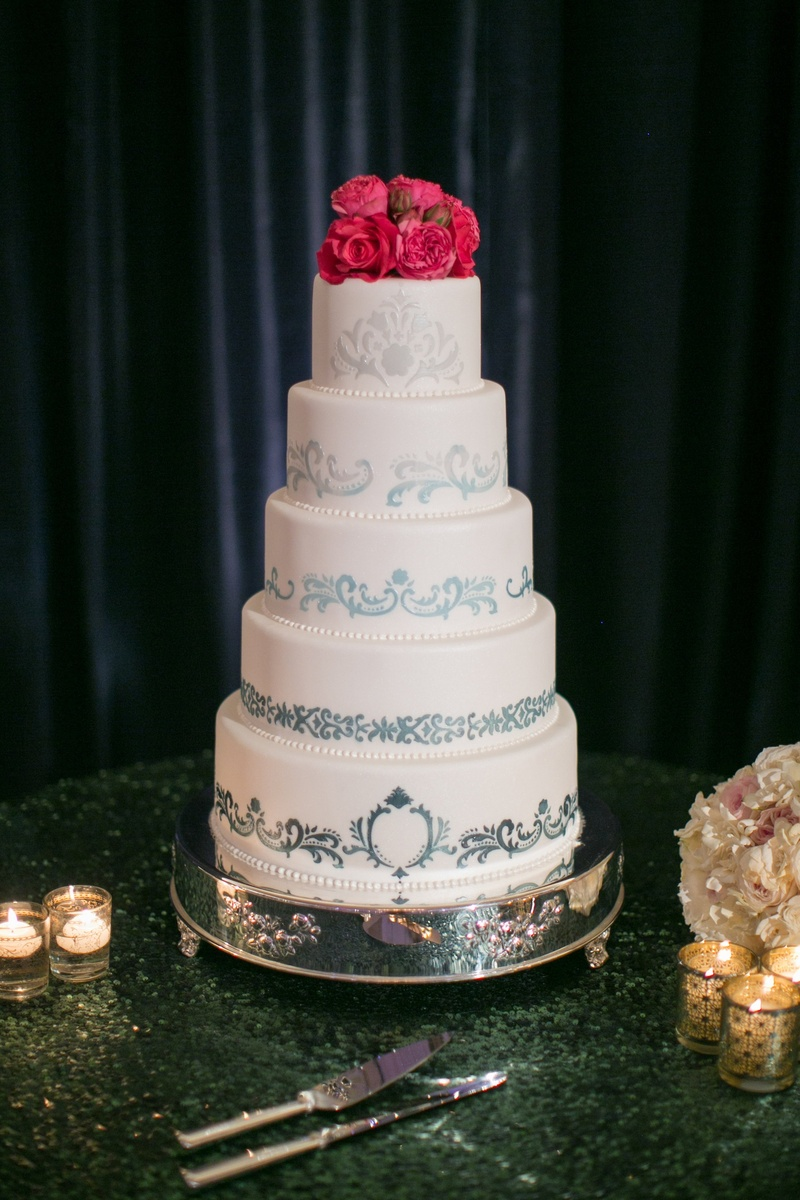 White Cake With Moroccan Handpainted Design And Pink Flower Topper