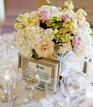 Ivory and pink flower centerpiece with framed table name