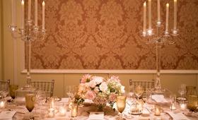 wedding reception damask wallpaper crystal candelabra low centerpiece pink white flowers gold
