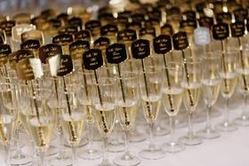 wedding reception ideas escort card alternatives drink stirrer gold etched champagne flutes