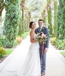 Bride in strapless wedding dress sheer side cutouts groom in grey suit florida wedding