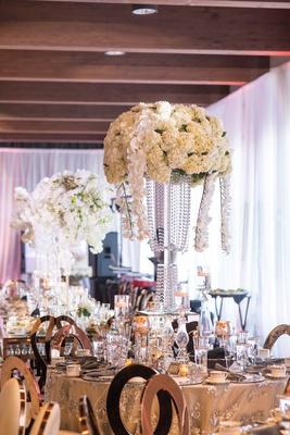 wedding reception centerpiece tall flower arrangement crystal vase orchid ivory hydrangea flowers