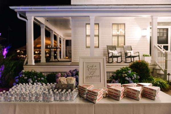 to-go pizza slices and water bottles for wedding favors