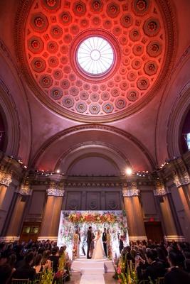 Historical wedding ceremony venue in Brookly, New York bride and groom jewish wedding colorful decor
