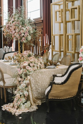 taupe linen intricate details champagne chairs cascading floral runner pink flowers foliage gold