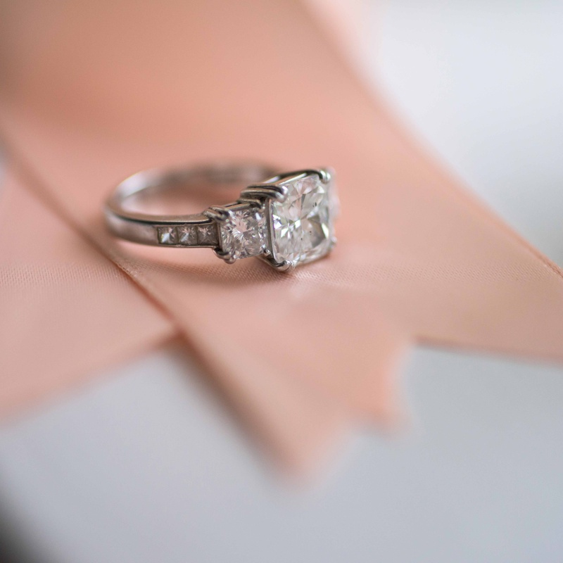 Jewelry Photos Cushion Cut Engagement Ring On Ribbon Inside Weddings