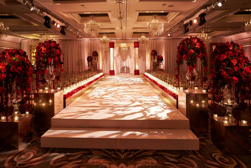 All White Indoor Wedding Ceremony Site: Elevated Aisle And Red Roses