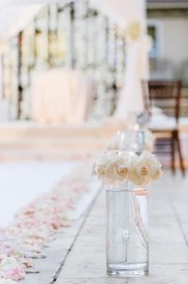 glass vase ivory roses line aisle blush rose petals