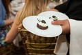 Waiter serving caviar cake at Beverly Hills bridal shower