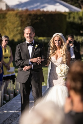 Bride in galia lahav mermaid wedding dress veil long blonde curled hair white bouquet with father