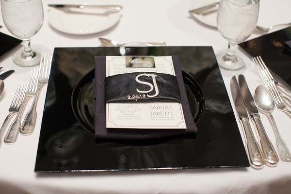 Black charger plate with embroidered menu wrap