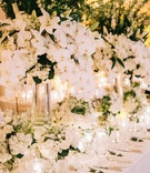 Wedding reception long table antique linen tablecloth white flowers greenery orchids lilies tall