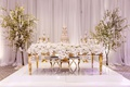 long rectangular gold sweetheart table nfl player tahir whitehead cake blossom trees white stage
