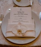Ritz-Carlton menu card and white orchid on napkin