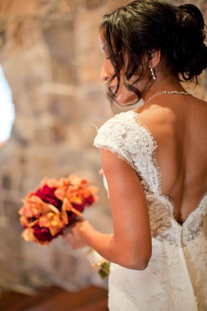 Bride in a lace wedding dress with a low V-neck back