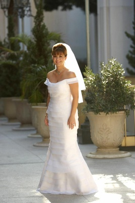 Bride wearing white chiffon bridal gown and veil