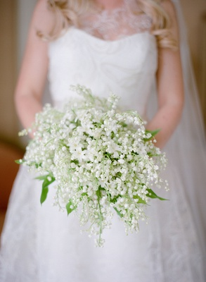 Bride in wedding dress by romona keveza wedding gown lily of the vallery and bluebell bouquet green