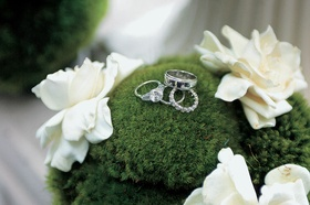 Platinum three-stone engagement ring with eternity band and men's ring