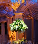 Blue chandelier over formal ballroom wedding table
