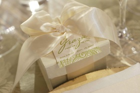 """white gift box with white satin ribbon and green """"grazie"""" tag"""