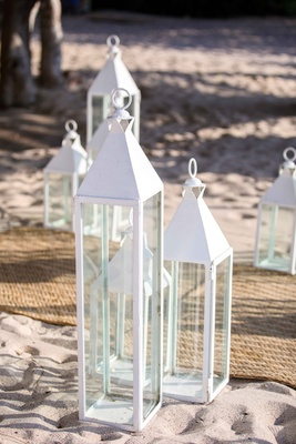 clean white lanterns beach ceremony punta mita mexico wedding styled shoot decor sand aisle items