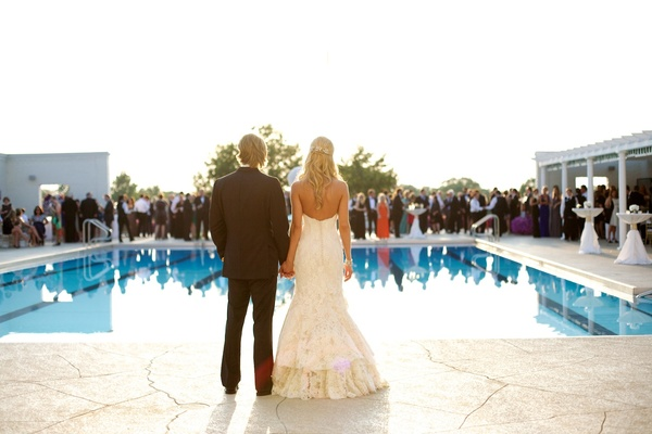Former Miss Illinois and her husband look at wedding guests