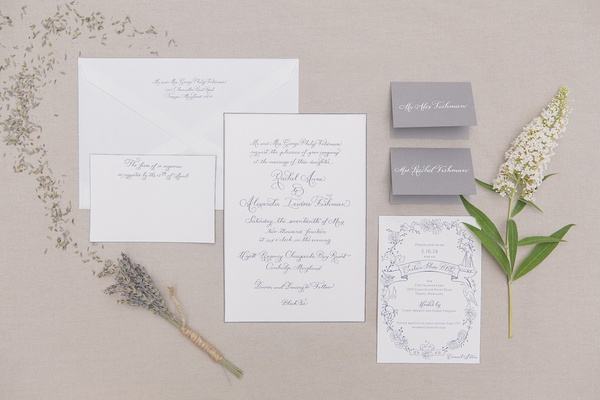 Sprig of lavender around wedding invitation