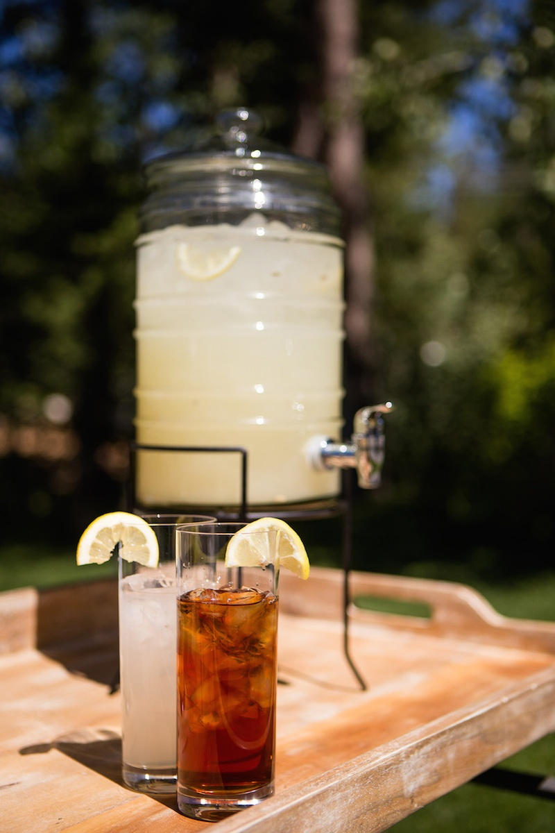 Glass dispenser with spout filled with fresh lemonade