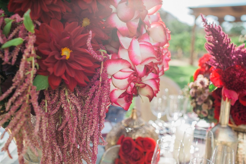 red dark purple flowers bouquets floral arrangements in gold vases vineyard reception décor