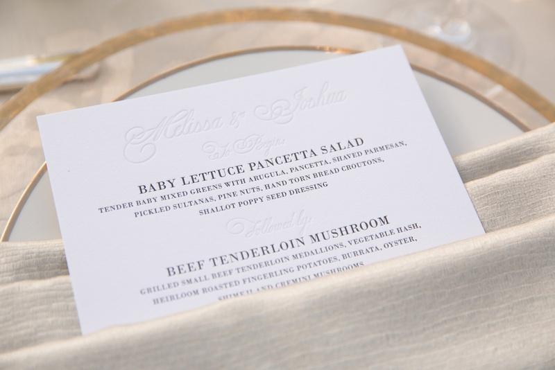 Wedding menu card tucked into neutral napkin