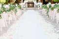 Wedding ceremony outdoors fireplace mantel at altar pink ribbon greenery white flower petals