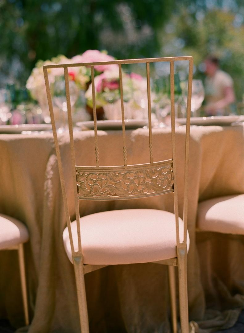 Wrought iron chairs with pink cushions