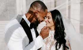 r&b singer tankr zena foster wedding, bride and groom pose under veil