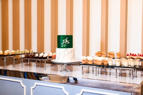 modern wedding dessert table, two tier wedding cake with emerald layer, small gourmet desserts