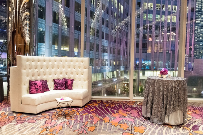 elegant las vegas wedding, lounge area with high back white sofa, silver sequin table cloth