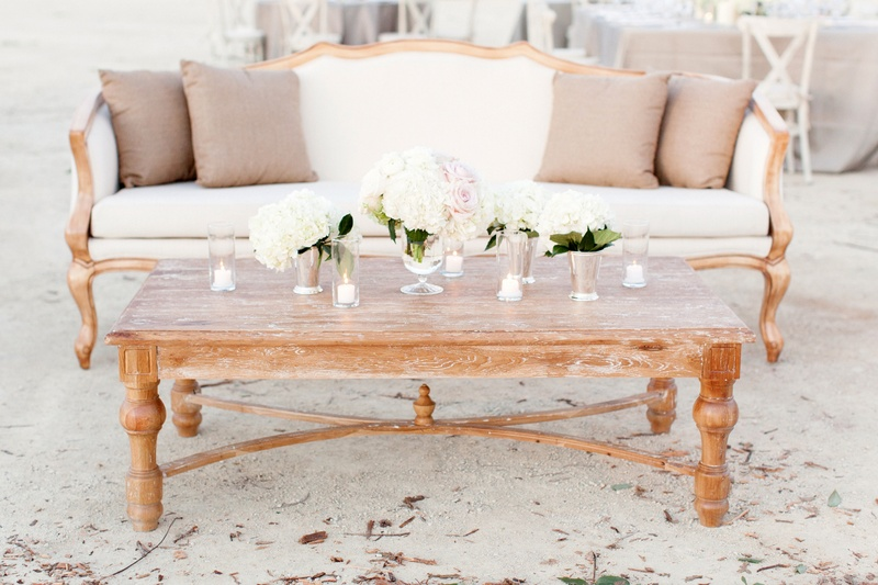 Wedding lounge with wood table and white sofa