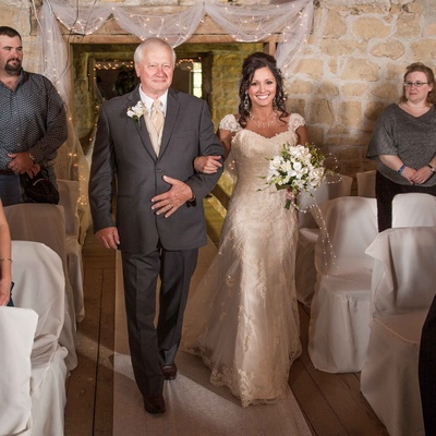 Bride in Maggie Sottero wedding dress with father of the bride