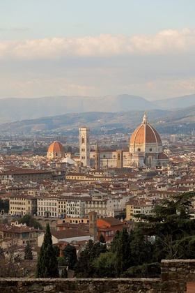 view of florence and the florence cathedral duomo with hills in the distance
