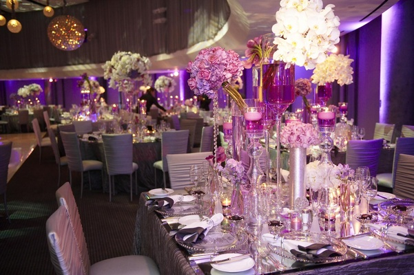 Glam modern wedding with purple dcor in los angeles california purple wedding reception decorations at skirball junglespirit