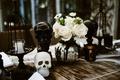 halloween wedding ideas wood table with mercury glass silver pumpkin centerpiece black white skulls