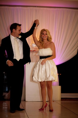 Bride in short bubble dress and feather bodice