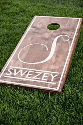 Wedding reception cocktail hour games corn hole custom board with monogram and last name