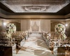 Mirrored aisle decor reflects soft ivory elegance.