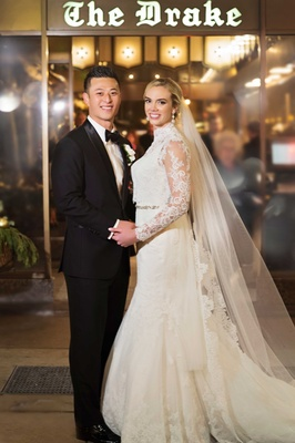 rob refsnyder of new york yankees and bride in matthew christopher gown outside the drake hotel