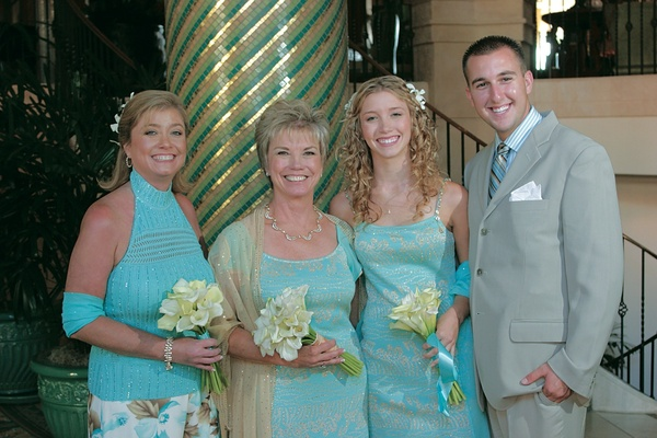 Bride in light blue dress and family