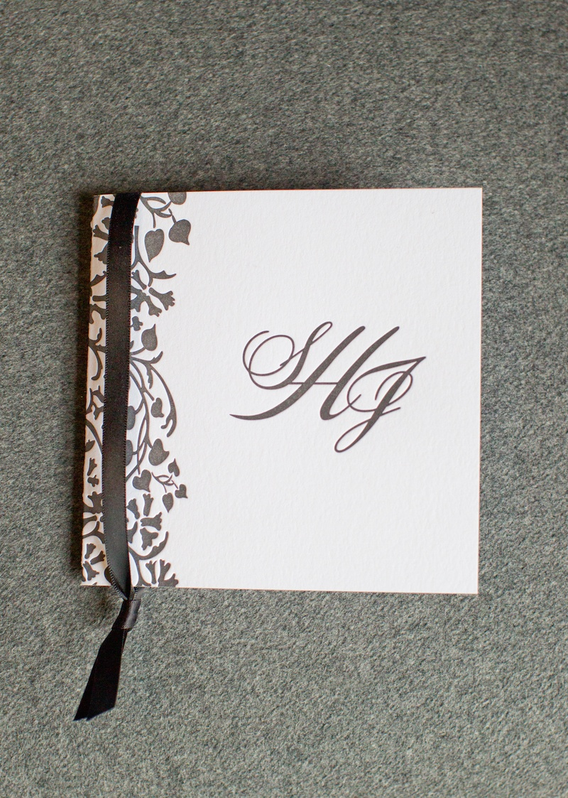 White square card with monogram and leaf motif