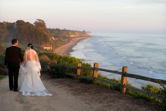 Bride and groom at Bacara Resort & Spa oceanfront walkway path