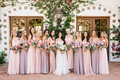 bride in galia lahav wedding dress bridesmaids in mismatch dresses light pink purple mauve lavender